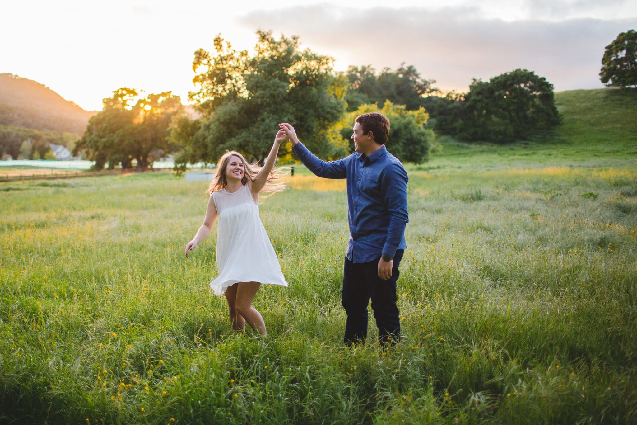 dancing in the field engagement shoot